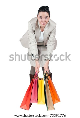 Beautiful young woman shopping and carrying paper bags