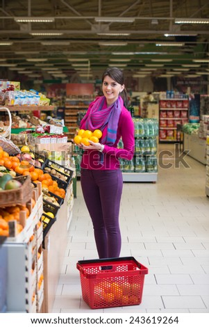 Beautiful Young Woman Shopping For Fruits And Vegetables In Produce Department Of A Grocery Store - Supermarket - Shallow Deep Of Field
