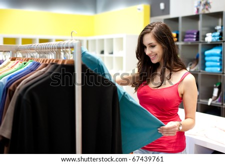 Beautiful young woman shopping in a department store. Shallow DOF.