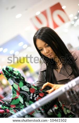 Beautiful young woman shopping in a store