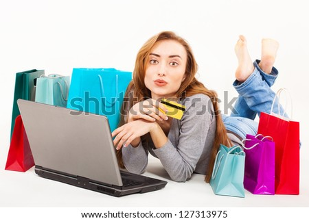 Beautiful young woman shopping over internet, online, isolated