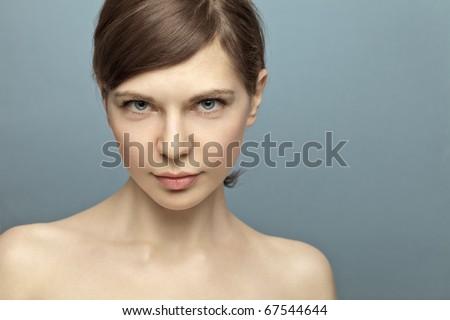 Beautiful young woman shot in studio no makeup. Natural beauty