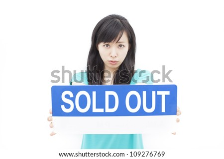 beautiful young woman showing SOLD OUT sign, isolated on white background