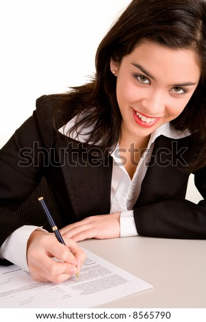 Beautiful Young Woman Signing a Document