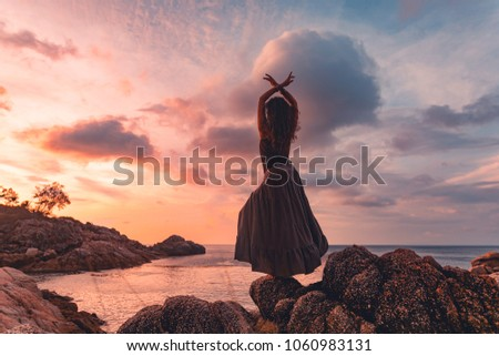 beautiful young woman silhouette on sunset