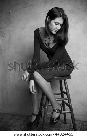beautiful young woman sitting on a chair