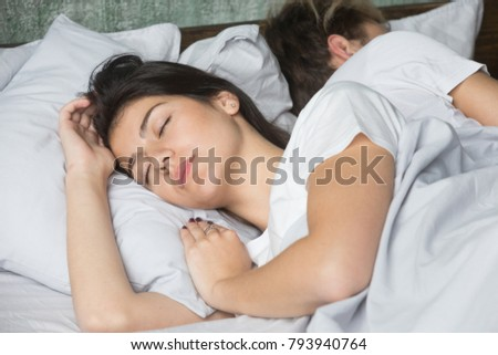 Beautiful young woman sleeping comfortably in cozy bed on soft pillow, girl asleep enjoying sleep dozing with boyfriend, attractive lady resting enough for keeping natural beauty good health balance