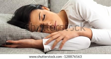 Beautiful Young Woman Sleeping On Sofa, Indoors