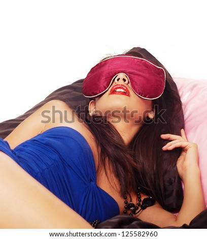 Beautiful young woman sleeping with eye mask on her face. - stock photo