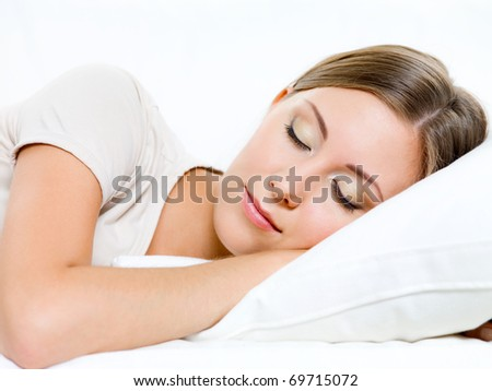 beautiful young woman sleeps on the sofa at home