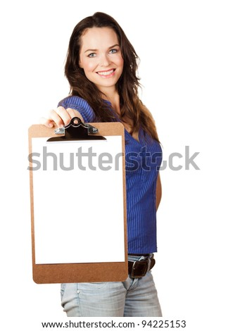 Beautiful young woman smiling and holding out a blank clipboard towards camera
