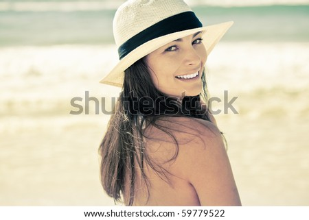 Beautiful young woman smiling at the beach