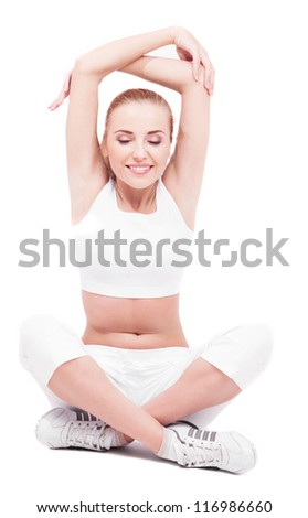 beautiful young woman stretching the muscles of her arms and back, isolated on white background