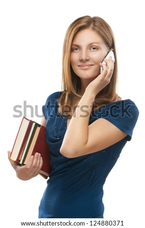 Beautiful young woman-student with books talking on cell phone, isolated on white background.