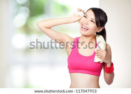 beautiful young woman take a rest after sport , wearing sports clothes, with nature green background, asian female model