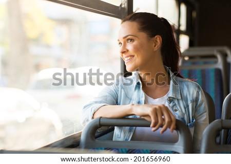 beautiful young woman taking bus to work