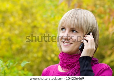 Beautiful young woman talking on a mobile phone.