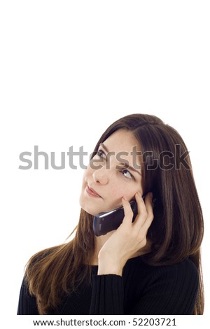 Beautiful young woman talking on the mobile phone,  she is looking up - thinking, a lot of copyspace.