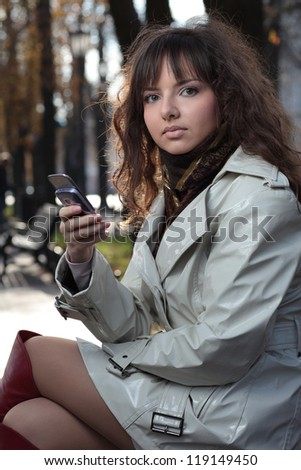 Beautiful young woman talking on the phone.