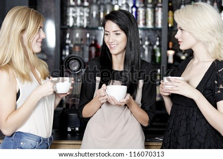 Beautiful young woman talking over coffee at a wine bar.