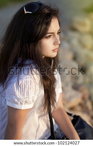 beautiful young woman thinking at summer green park enjoying sun, nice female in garden relaxing outdoor, Teenage girl looking thoughtful, young lady and spring green nature, harmony concept