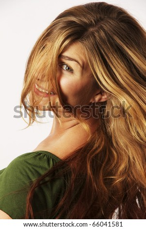 Beautiful young woman tossing her hair