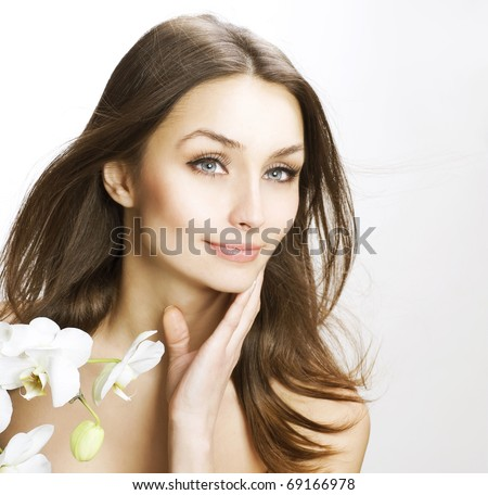 Beautiful Young Woman touching her face.Fresh skin
