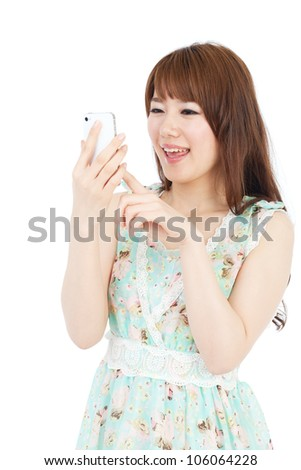 Beautiful young woman using a mobile phone. Portrait of asian.
