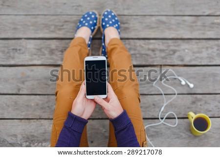 Beautiful young woman using smart phone at beach