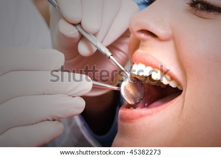 beautiful young woman visiting dentist for dental checkup