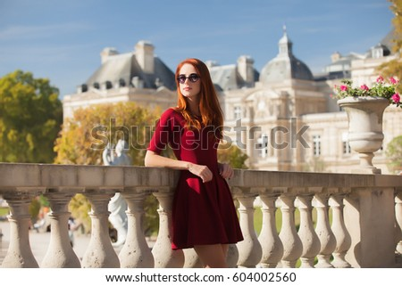 beautiful young woman walking in the park on the mansion background, Paris #604002560