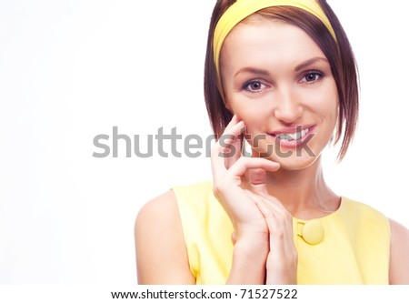 beautiful young woman wearing a yellow retro dress and a hair band