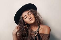 Beautiful young woman wearing hat portrait