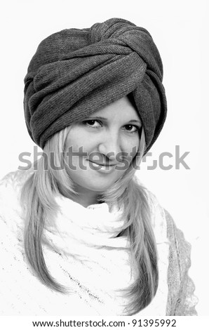 Beautiful young woman wearing winter knitten turban