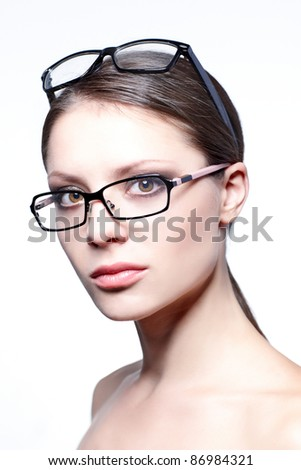 Beautiful young woman wears trendy glasses.