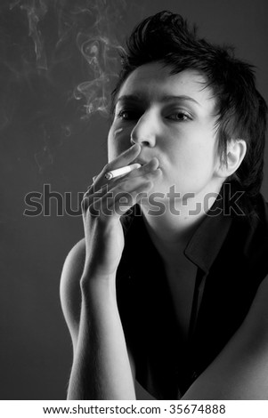 Beautiful young woman with a cigarette and smoke