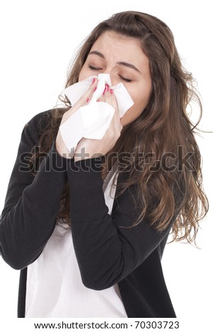 Beautiful young woman with a cold blowing nose
