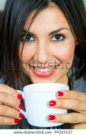 beautiful young woman with a cup of coffee at home