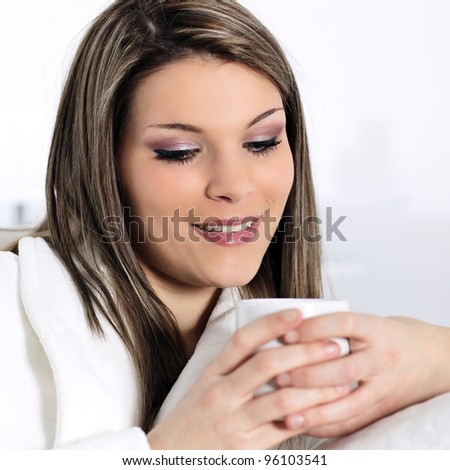 beautiful young woman with a cup of tea at home