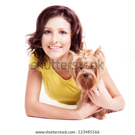 beautiful young woman with a dog, isolated against white background