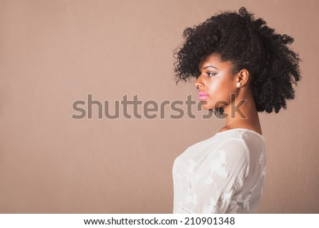 Beautiful young woman with afro in studio #210901348