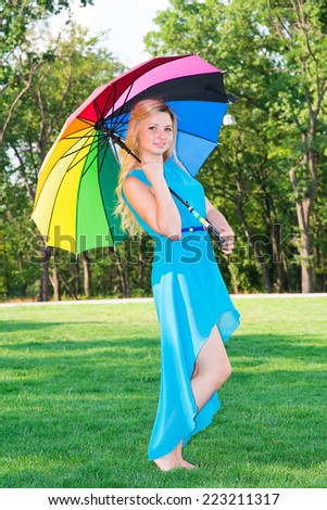 beautiful young woman with an umbrella rainbow