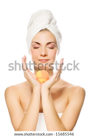 Beautiful young woman with aroma bath ball isolated on white background