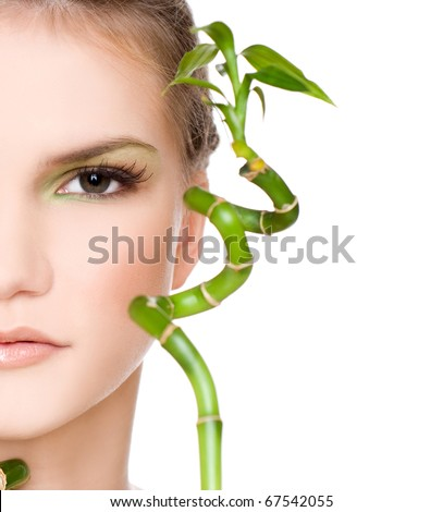 beautiful young woman with bamboo