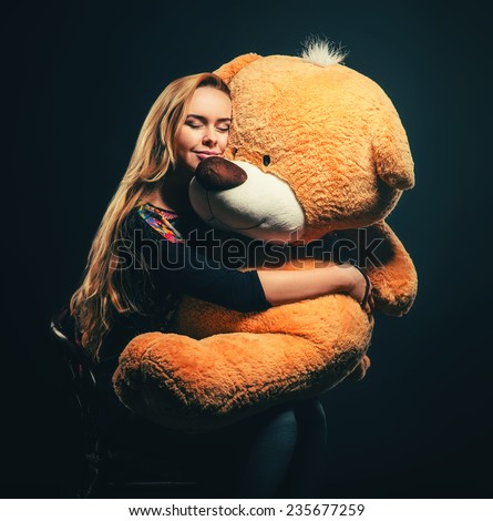 beautiful young woman with big teddy bear