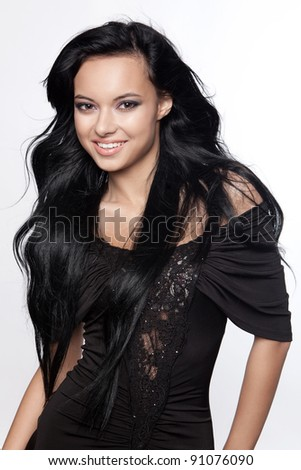 Beautiful young woman with black, long hair