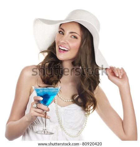 Beautiful young woman with blue cocktail