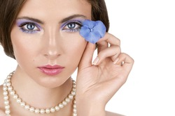 Beautiful young woman with blue flower