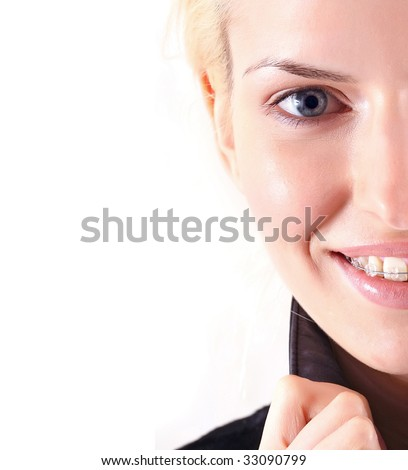 Beautiful young woman with brackets on teeth in white close up, isolated on a white background, please see some of my other parts of a body images