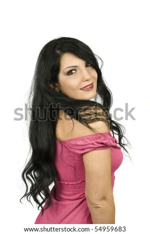 Beautiful young woman  with brown eyes looking over shoulders showing her long black  hair